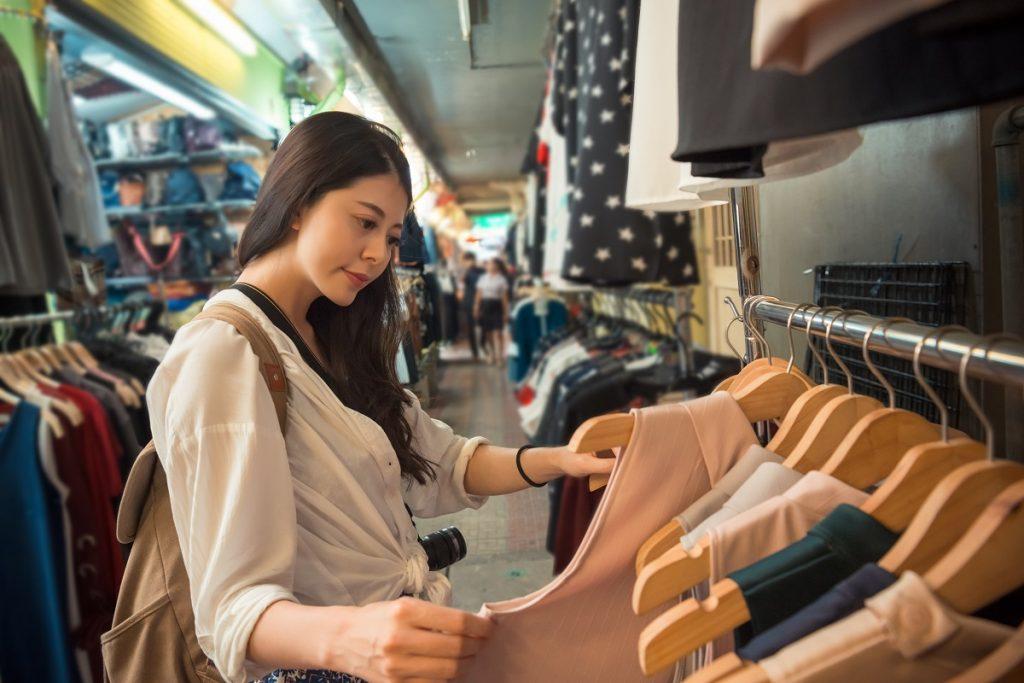 asian young woman shopping choosing clothing
