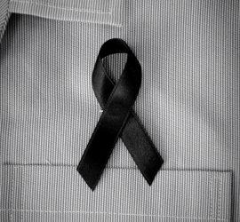 black awareness ribbon on shirt
