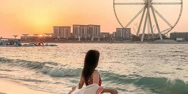 Girl watches sunset at The Beach Dubai - Shopping in Dubai