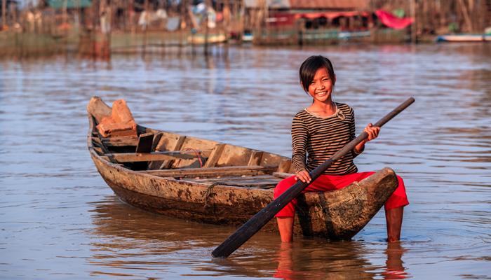 Cambodian girl in canoe