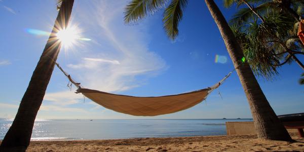 A hammock between two trees on beach in Hua Hin